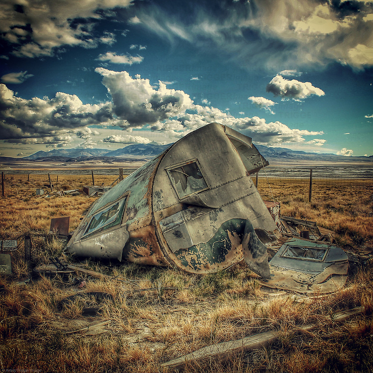 An abandoned caravan in a remote country location in USA under blue sky