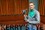 Na Gaeil's Paul Daly with the All Ireland Junior Club Championship Cup in the clubhouse on Monday