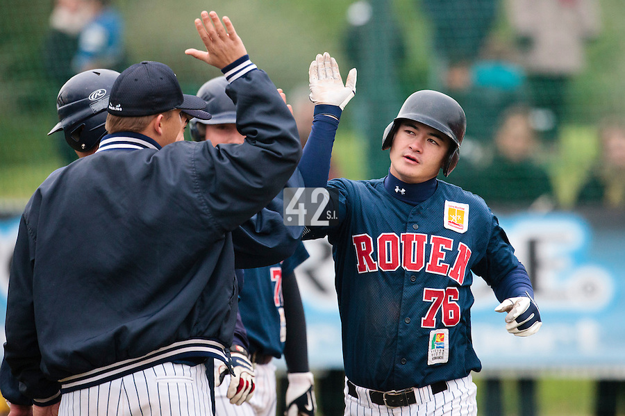 17 October 2010: Kenji Hagiwara of Rouen is congratulated after blasting a solo home run during Rouen 10-5 win over Savigny, during game 2 of the French championship finals, in Savigny sur Orge, France.