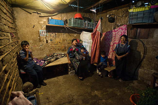 The family of three-year-old Santos, second from right, live in a two-room-house. The oldest child sleep ina bed in his room and the rest of four share two wooden beds that have no mattress.