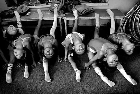 Girls stretch at the beginning of a controtion class in Ulan Bator.