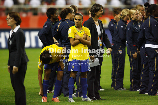 SHANGHAI - SEPTEMBER 30:  Marta of Brazil (10) looks disappointed while waiting for the post-match ceremonies after Germany defeated Brazil in the FIFA Women's World Cup soccer final September 30, 2007 in Shanghai, China.  (Photograph by Jonathan P. Larsen)