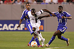 11 March 2008: Maurice Edu (USA) (6) splits the defense of Enrique Villaurrutia (CUB) (11) and another Cuba player (left). The United States U-23 Men's National Team tied the Cuba U-23 Men's National Team 1-1 at Raymond James Stadium in Tampa, FL in a Group A game during the 2008 CONCACAF's Men's Olympic Qualifying Tournament.
