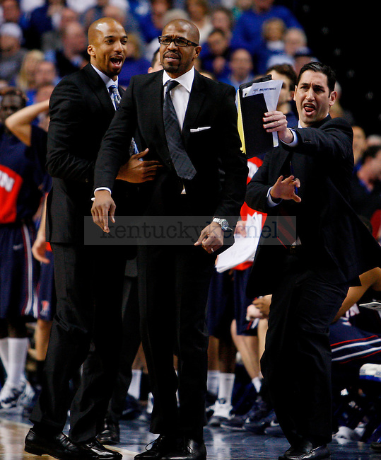 Penn heach coach Jerome Allen gets held back by his assistants in the first half of UK's win over the Penn Quakers at Rupp Arena on Jan. 3, 2011. Photo by Britney McIntosh | Staff