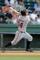 Catcher Tanner Murphy (14) of the Rome Braves bats in a game against the Greenville Drive on Monday, June 15, 2015, at Fluor Field at the West End in Greenville, South Carolina. Greenville won, 9-3. (Tom Priddy/Four Seam Images)