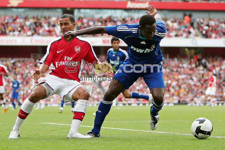 PICTURE BY JEREMY RATA/SWPIX.COM - Football - Emirates Cup 2008 - Arsenal v Real Madrid - Emirates Stadium, London, England - 03/08/08....Copyright - Simon Wilkinson - 07811267706...Arsenal's Theo Walcott receives a smack in the mouth from Real Madrid's Mahamadu Diarra.