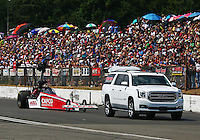 Aug. 2, 2014; Kent, WA, USA; NHRA top fuel dragster driver Steve Torrence on the return road during qualifying for the Northwest Nationals at Pacific Raceways. Mandatory Credit: Mark J. Rebilas-