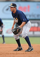 First baseman Kevin Mahoney (26) of the Charleston RiverDogs, Class A affiliate of the New York Yankees, in a game against the Greenville Drive on July 31, 2011, at Fluor Field at the West End in Greenville, South Carolina. (Tom Priddy/Four Seam Images)