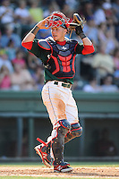 Catcher Carlos Coste (7) of the Greenville Drive looks back at the dugout for signals in a game against the Savannah Sand Gnats on Sunday, June 22, 2014, at Fluor Field at the West End in Greenville, South Carolina. Greenville won, 7-3. (Tom Priddy/Four Seam Images)