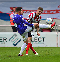 Lincoln City's Scott Wharton vies for possession with Exeter City's Lloyd James<br /> <br /> Photographer Andrew Vaughan/CameraSport<br /> <br /> The EFL Sky Bet League Two Play Off First Leg - Lincoln City v Exeter City - Saturday 12th May 2018 - Sincil Bank - Lincoln<br /> <br /> World Copyright &copy; 2018 CameraSport. All rights reserved. 43 Linden Ave. Countesthorpe. Leicester. England. LE8 5PG - Tel: +44 (0) 116 277 4147 - admin@camerasport.com - www.camerasport.com