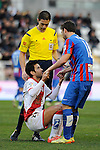 Levante UD´s Victor Casadesus Castano helps to stand up Rayo Vallecano´s Alberto Bueno while refrere looks during 2014-15 La Liga match between Rayo Vallecano and Levante UD at Vallecas stadium in Madrid, Spain. February 28, 2015. (ALTERPHOTOS/Luis Fernandez)