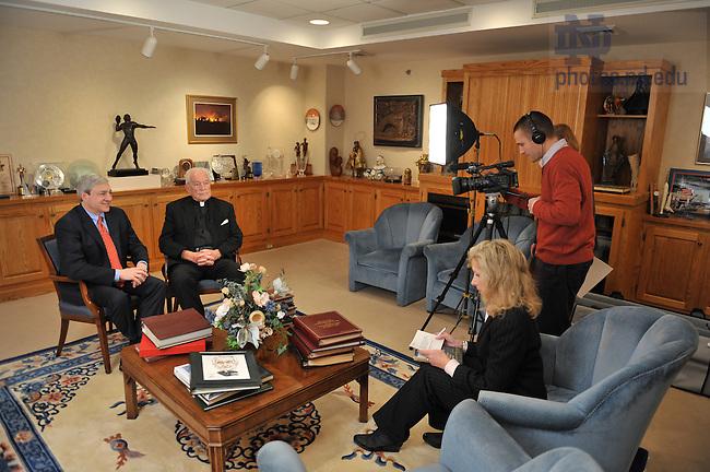 Penn State president Graham Spanier and Notre Dame President Emeritus Rev. Theodore Hesburgh, C.S.C. are interviewed in Hesburgh's office...Photo by Matt Cashore/University of Notre Dame