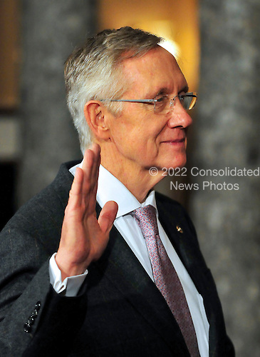 United States Senate Majority Leader Harry Reid (Democrat of Nevada) raises his right hand during the photo-op of the reenactment of his swearing-in in the Old Senate Chamber in the U.S. Capitol in Washington, D.C. on Wednesday, January 5, 2011..Credit: Ron Sachs / CNP.(RESTRICTION: NO New York or New Jersey Newspapers or newspapers within a 75 mile radius of New York City)