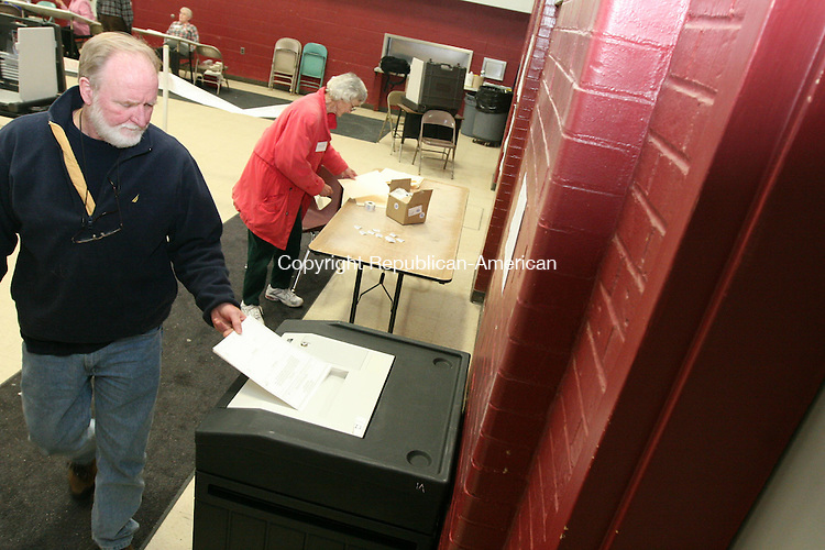 "WINSTED, CT - 31 January, 2009 - 013109MO03 - Mark Jones, 58, casts a ballot in favor of Winsted's $32 million 2008-09 budget proposal Saturday at Pearson Middle School. Jones said the budget is ""lower than it should be, but I don't want to see it go any lower."" Jim Moore Republican-American."