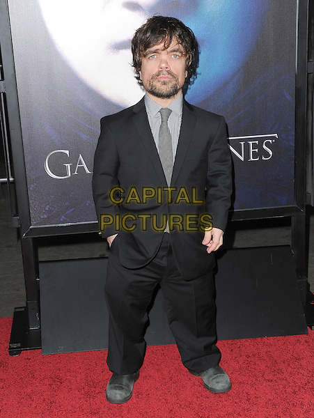 "Peter Dinklage .""Game Of Thrones"" 3rd Season Los Angeles Premiere held at the TCL Chinese Theatre, Hollywood, California, USA..March 18th, 2013.full length hand in pocket black suit white check shirt beard facial hair .CAP/RKE/DVS.©DVS/RockinExposures/Capital Pictures."
