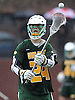 Connor Grippe #24 of Ward Melville makes a pass during a a non-league varsity boys lacrosse game against host Chaminade High School on Saturday, Apr. 2, 2016. Ward Melville won by a score of 9-8.