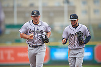 Kane County Cougars Buddy Kennedy (7) and Eduardo Diaz (1) jog off the field between innings of a Midwest League game against the Fort Wayne TinCaps at Parkview Field on May 1, 2019 in Fort Wayne, Indiana. Fort Wayne defeated Kane County 10-4. (Zachary Lucy/Four Seam Images)