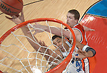 4 APR 2005: Center Sean May (42) of North Carolina is fouled while going to the basket by Center Jack Ingram (50) of Illinois during the Men's Final Four Championship game held at the Edward Jones Dome in St. Louis, MO. The North Carolina Tar Heels went on to defeat the University of Illinois Fighting Illini 75-70 to claim the championship title. Ryan McKee/NCAA Photos
