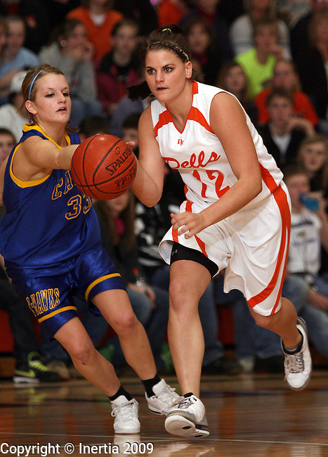 DELL RAPIDS, SD - FEBRUARY 3:  Dena Reiff #12 of Dell Rapids pushes the ball past the defense of Stephanie Miller #33 of Canton in the second half of their game Tuesday night in Dell Rapids. (Photo by Dave Eggen/Inertia)