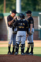 Bristol Pirates pitching coach Joseph Seaver (71) talks with starting pitcher Shane Baz (10) and catcher Gabriel Brito (52) on the mound during a game against the Elizabethton Twins on July 28, 2018 at Joe O'Brien Field in Elizabethton, Tennessee.  Elizabethton defeated Bristol 5-0.  (Mike Janes/Four Seam Images)