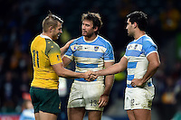 Drew Mitchell of Australia commiserates with Marcelo Bosch and Jeronimo de la Fuente of Argentina after the match. Rugby World Cup Semi Final between Argentina v Australia on October 25, 2015 at Twickenham Stadium in London, England. Photo by: Patrick Khachfe / Onside Images