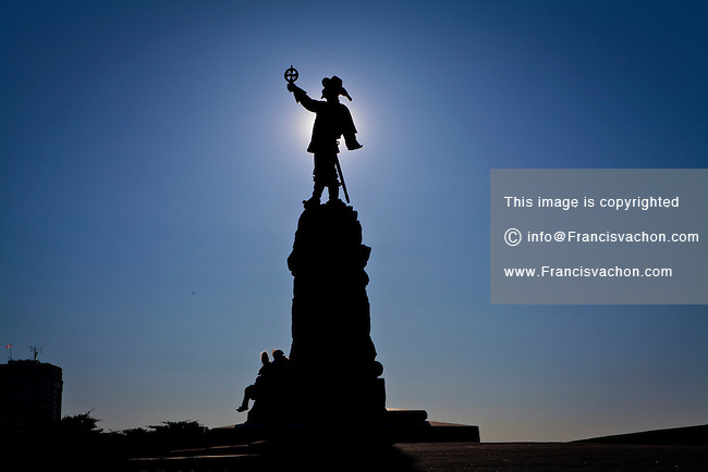 "A statue of Samuel de Champlain is silhouetted against a setting sun at Nepean Point in Ottawa April 29, 2012. A French navigator, ""The Father of New France"" was a cartographer, draughtsman, soldier, explorer, geographer, ethnologist, diplomat, and chronicler who founded New France and Quebec City."