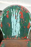 Peeling paint on patio chair.