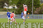 Pictured on Sunday for the Castleisland Mart Junior County Championship Quarter-Final, Brosna V Templenoe in Pairc na Feile Brosna. <br /> Brosna's Daniel Fitzgerald and Templenoe's John Rice Challenge high for the ball.