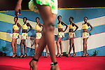 KINSHASA, DEMOCRATIC REPUBLIC OF CONGO APRIL 21: Unidentified contestants in the Miss Congo contest show their stuff for the jury on April 21, 2006 in central Kinshasa, Congo, DRC. About twenty girls from all over Congo, DRC competed to win the crown at the Grand Hotel in Kinshasa. Diane Muzungu from the Katanga province won. Congo DRC, returned to the Miss World contest only in 2005, after almost two decades absence. Kinshasa, a city of about eight million people is battling with bad infrastructure and no public transport. Congo, DRC is in ruins after forty years of mismanagement by the corrupt dictator and former president Mobuto Sese Seko. He fled the country in 1997 and a civil war started. The country is planning to hold general elections by July 2006, the first democratic elections in forty years.(Photo by Per-Anders Pettersson)
