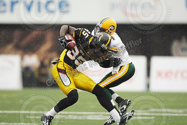 August 8, 2009; Hamilton, ON, CAN; Hamilton Tiger-Cats wide receiver Prechae Rodriguez (85) is tackled by Edmonton Eskimos defensive back Jason Goss (4). CFL football: Edmonton Eskimos vs. Hamilton Tiger-Cats at Ivor Wynne Stadium. The Tiger-Cats defeated the Eskimos 28-21. Mandatory Credit: Ron Scheffler. Copyright (c) 2009 Ron Scheffler.
