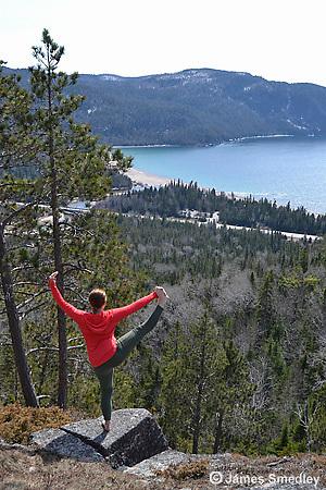 Girl doing acrobatics on scenic lookout