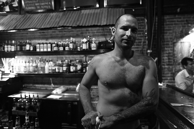 A bartender goes shirtless at The Hummingbird Stage and Taproom, during the Bragg Jam Music Festival in Macon, Ga. July 31, 2010.