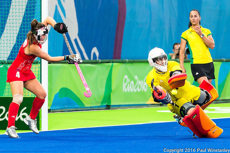 Maddie Hinch #1 of Great Britain makes the save while Laura Unsworth #4 of Great Britain covers the post during Netherlands vs Great Britain in the gold medal final at the Rio 2016 Olympics at the Olympic Hockey Centre in Rio de Janeiro, Brazil.