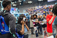 Participants use a Samsung Gear VR virtual reality device a the Two Sigma Investments booth at a Career Expo held at the FIRST Robotics NYC Championship at the Jacob Javits Convention Center in New York on Sunday, March 13, 2016. The expo enables participants to speak with companies and professional organizations giving a real-world look into science and technology as used in the business world and their career opportunities. (© Richard B. Levine)