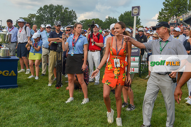 Jena Sims prepares to rush Brooks Koepka (USA) on the green on 18 following the 100th PGA Championship at Bellerive Country Club, St. Louis, Missouri. 8/12/2018.<br /> Picture: Golffile   Ken Murray<br /> <br /> All photo usage must carry mandatory copyright credit (© Golffile   Ken Murray)