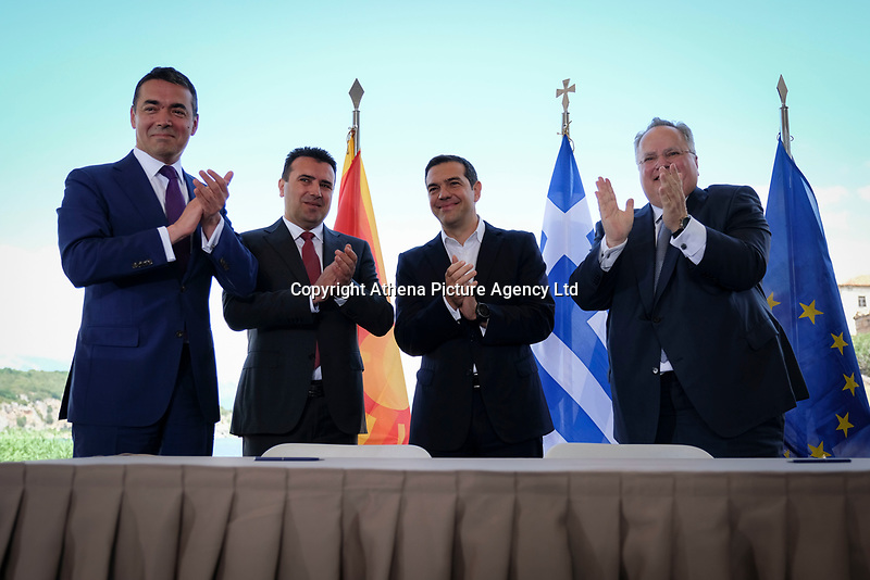 Pictured: (L-R) Nikola Dimitrov Minister of Foreign Affairs of FYROM, Prime Minister for FYROM Zoran Zaevat, Greek Prime Minister Alexis Tsipras and Greek foreign minister Nikos Kotzias at Prespa Lake in northern Greece. Sunday 17 June 2018 <br /> Re: Greece and the Former Yugoslav Republic Of Macedonia (FYROM) have signed a deal that aims to settle a decades-long dispute over the country's name.<br /> Under the agreement, Greece's neighbour will be known as North Macedonia.<br /> Heated rows over Macedonia's name have been going on since the break-up of the former Yugoslavia, of which it was a part, and have held up Macedonia's entry to Nato and the EU.<br /> Greece has long argued that by using the name Macedonia, its neighbour was implying it had a claim on the northern Greek province also called Macedonia.<br /> The two countries' leaders, Mr Tsipras and his Macedonian counterpart Zoran Zaev announced the deal on Tuesday and have pressed ahead despite protests.<br /> The two countries' foreign ministers signed the deal on Lake Prespa on Greece's northern border on Sunday.<br /> The agreement still needs to be approved by both parliaments and by a referendum in Macedonia.