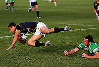 Manawatu first five Aaron Cruden tackles Alapeti Leiua during the Air NZ Cup preseason match between Manawatu Turbos and Wellington Lions at FMG Stadium, Palmerston North, New Zealand on Friday, 17 July 2009. Photo: Dave Lintott / lintottphoto.co.nz