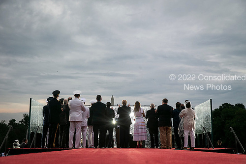 """U.S. President Donald Trump and first lady Melania Trump watch with U.S. Vice President Mike Pence and guests as military planes fly overheard during the Fourth of July Celebration 'Salute to America' event in Washington, D.C., U.S., on Thursday, July 4, 2019. The White House said Trump's message won't be political -- Trump is calling the speech a """"Salute to America"""" -- but it comes as the 2020 campaign is heating up. <br /> Credit: Al Drago / Pool via CNP"""