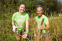 Jade Jordan,'19, and Mikayla Crieger,'19, snip cattails at the Potter League For Animals as they begin their Salve Regina community service project.