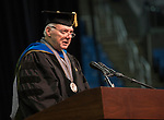 Marc Johnson speaks during the University of Nevada, Reno morning Winter Commencement Ceremony at Lawlor Events Center in Reno, Saturday, Dec. 9, 2017.