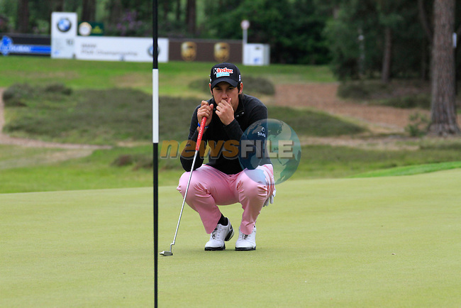 Matteo Manassero (ITA) lines up his putt on the 10th green during Day 3 of the BMW PGA Championship Championship at, Wentworth Club, Surrey, England, 28th May 2011. (Photo Eoin Clarke/Golffile 2011)