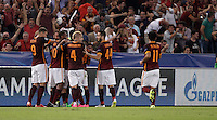 Calcio, Champions League, Gruppo E: Roma vs Barcellona. Roma, stadio Olimpico, 16 settembre 2015.<br /> Roma&rsquo;s Alessandro Florenzi is hidden by teammates' hugs after scoring during a Champions League, Group E football match between Roma and FC Barcelona, at Rome's Olympic stadium, 16 September 2015.<br /> UPDATE IMAGES PRESS/Isabella Bonotto