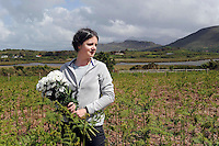 Angela Griffin lays a wreath in the Killeen at Dooks, Glenbeigh with Graham Clifford.<br /> Picture by Don MacMonagle