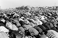"Iraq. Baghdad. Al Sadr City. Men bend their heads down on the ground for the midday prayer on friday during the month of Moharam which is considerated as one of the most important feast for the Shiism branch of Islam. Muharram is a month of remembrance that is often considered synonymous with the event of Ashura. Ashura, which literally means the ""Tenth"" in Arabic, refers to the tenth day of Muharram. It is well-known because of historical significance and mourning for the martyrdom of Hussein ibn Ali, the grandson of Muhammad. Shi'a Muslims start the mourning from the 1st night of Muharram and continue for two months and eight days. However the last days are the most important since these were the days where Hussein and his family and followers were killed in the Battle of Karbala which took place on Muharram 10, in the year 61 of the Islamic calendar (October 10, 680). Muharam's month is considerated as one of the most important feast for the Shiism branch of Islam. Shia Islam is the second largest denomination of Islam. The followers of Shia Islam are called Shi'ites or Shias. 20.02.04 © 2004 Didier Ruef ."