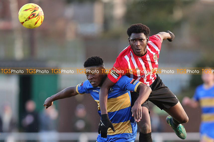 Tobi Coker of Hornchurch tangles with Ayodeji Olukoga of Romford during AFC Hornchurch vs Romford, Ryman League Division 1 North Football at Hornchurch Stadium on 4th February 2017
