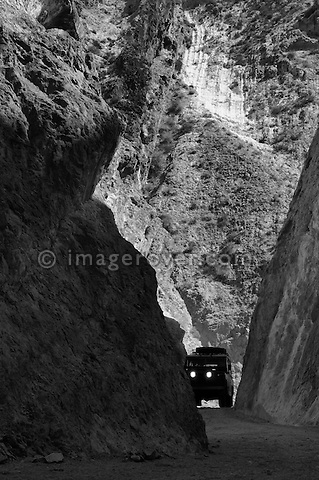 Africa, Tunisia, nr. Saket. Historic Land Rover Series 2a descending through the famous narrow gorge south of Saket. --- No releases available, but releases may not be needed for certain uses. Automotive trademarks are the property of the trademark holder, authorization may be needed for some uses.  --- Info: Image belongs to a series of photographs taken on a journey to southern Tunisia in North Africa in October 2010. The trip was undertaken by 10 people driving 5 historic Series Land Rover vehicles from the 1960's and 1970's. Most of the journey's time was spent in the Sahara desert, especially in the area around Douz, Tembaine, Ksar Ghilane on the eastern edge of the Grand Erg Oriental.