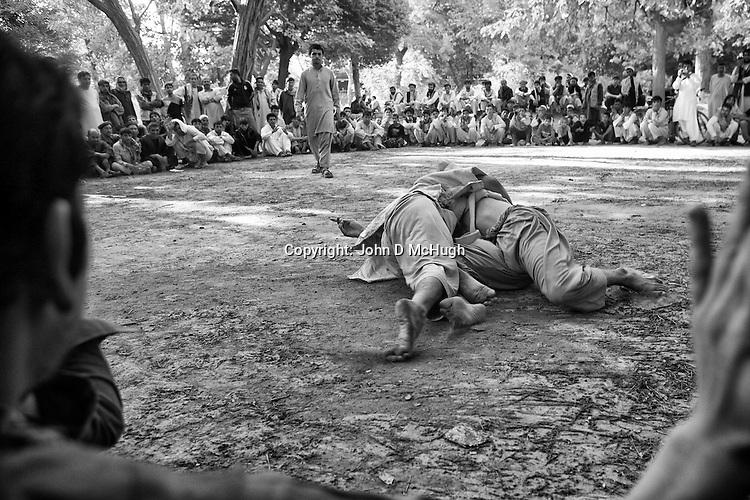 Afghan men wrestle in Shar-I Now park, 31 August 2012. (John D McHugh)