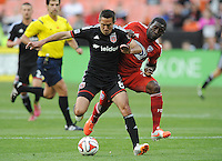 Washington D.C. - April 26, 2014:  Davy Arnaud (8) of D.C. United goes against Hendry Thomas (20) of FC Dallas. D.C. United defeated the FC Dallas 4-1 during a Major League Soccer match for the 2014 season at RFK Stadium.
