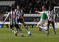 Paul Hanlon jumping in ahead of Paul McGowan in the St Mirren v Hibernian Clydesdale Bank Scottish Premier League match played at St Mirren Park, Paisley on 29.4.12.