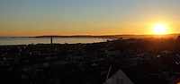 WEATHER PICTURE<br /> Pictured: The sun sets over roof tops in Swansea Bay in south Wales, UK. Tuesday 29 November 2016<br /> Re: Temperatures close to freezing affect parts of England and Wales.